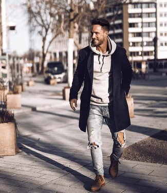How to Wear Brown Suede Casual Boots For Men: A black overcoat and light blue ripped skinny jeans are great menswear must-haves that will integrate nicely within your casual styling collection. Finishing with a pair of brown suede casual boots is a simple way to give an extra touch of polish to your look.