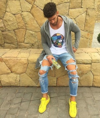 How to wear: yellow low top sneakers, light blue ripped skinny jeans, white print tank, grey hoodie