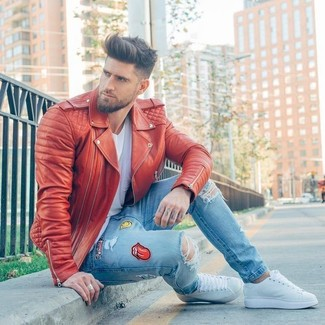 How to wear: white leather low top sneakers, light blue embellished skinny jeans, white v-neck t-shirt, red leather biker jacket