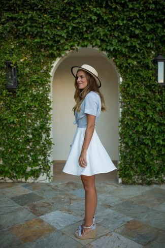 How to Wear a White Skater Skirt: A light blue short sleeve button down shirt and a white skater skirt are a great ensemble to add to your current casual wardrobe. If in doubt as to the footwear, complete your ensemble with a pair of light blue canvas wedge sandals.