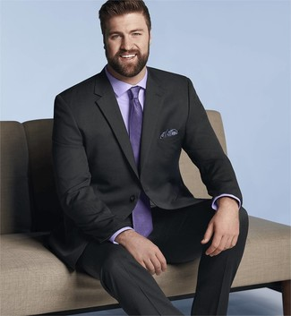 How to Wear a Black Suit: Marrying a black suit and a light violet dress shirt is a surefire way to inject your wardrobe with some rugged elegance.