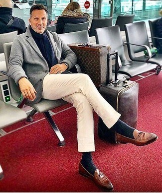 How to Wear Brown Leather Loafers After 40 For Men: A grey wool blazer and white chinos are the ideal way to inject some rugged refinement into your day-to-day off-duty fashion mix. Dial up the formality of your look a bit by wearing brown leather loafers.