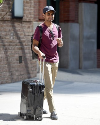 How to wear: black backpack, black leather loafers, beige chinos, purple crew-neck t-shirt