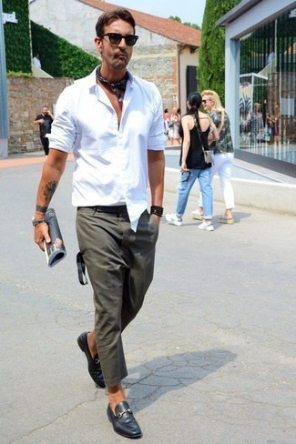 How to Wear Black Leather Loafers For Men: Why not pair a white long sleeve shirt with dark green chinos? These two items are very practical and will look awesome combined together. If you want to effortlesslly spruce up your outfit with a pair of shoes, why not introduce a pair of black leather loafers to the mix?