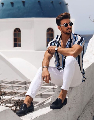 How to wear: black sunglasses, black leather loafers, white chinos, white and blue vertical striped short sleeve shirt