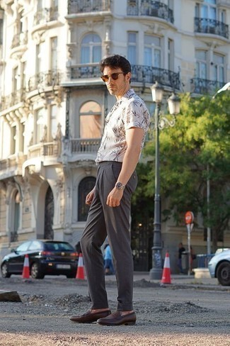 Men's Looks & Outfits: What To Wear In 2020: Wear a white print short sleeve shirt and charcoal chinos for a day-to-day ensemble that's full of charisma and character. For a classier twist, complete your outfit with dark brown leather loafers.