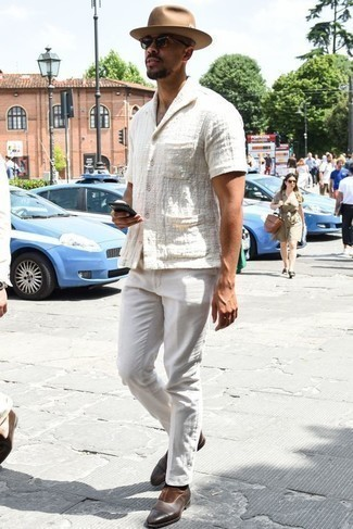 How to Wear Dark Brown Leather Loafers For Men: This combination of a white short sleeve shirt and white chinos is uber versatile and provides instant cool. Tap into some David Beckham stylishness and complete your getup with a pair of dark brown leather loafers.