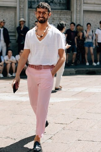 How to Wear a White V-neck T-shirt For Men: This casual pairing of a white v-neck t-shirt and pink chinos is extremely easy to put together in no time, helping you look awesome and ready for anything without spending too much time combing through your wardrobe. To add a bit of classiness to your outfit, rock a pair of navy leather loafers.