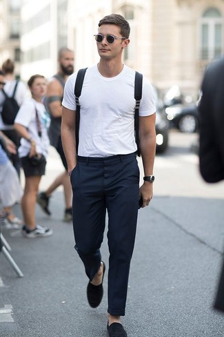 How to wear: black canvas backpack, black suede loafers, black dress pants, white crew-neck t-shirt