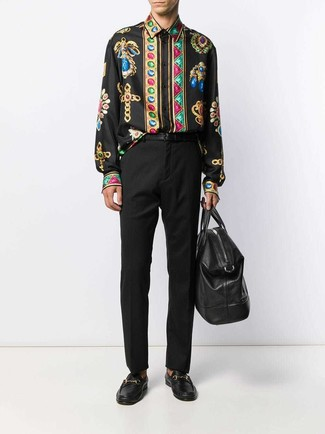How to wear: black leather holdall, black leather loafers, black dress pants, black print long sleeve shirt