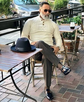 How to Wear Brown Socks For Men: This combo of a beige mock-neck sweater and brown socks is definitive proof that a simple casual outfit can still look really interesting. Introduce a pair of black leather loafers to the mix to make the ensemble slightly more polished.