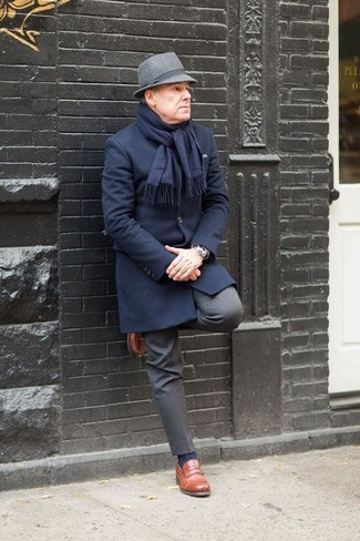 How to wear: grey wool hat, brown leather loafers, charcoal dress pants, navy overcoat