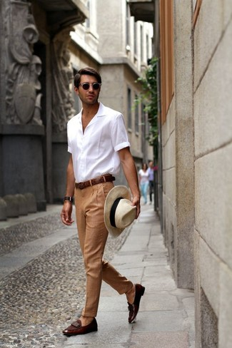 How to wear: beige straw hat, dark brown leather loafers, khaki dress pants, white short sleeve shirt