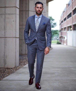 How to wear: light blue vertical striped tie, burgundy leather loafers, light blue dress shirt, blue suit