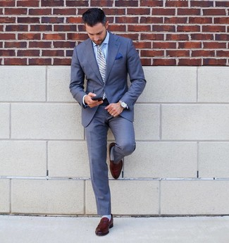 How to wear: light blue vertical striped tie, brown leather loafers, light blue dress shirt, blue suit