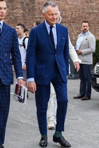 How to Wear Black Leather Loafers For Men: This combination of a navy suit and a light blue dress shirt is a foolproof option when you need to look incredibly stylish and refined. Dial up your whole look by rounding off with a pair of black leather loafers.