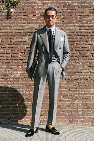 How to Wear a Black Knit Tie For Men: You're looking at the definitive proof that a grey suit and a black knit tie look awesome when married together in a sophisticated ensemble for today's gent. Finishing with a pair of black velvet loafers is a surefire way to infuse a playful vibe into your getup.