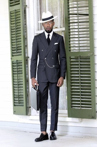 How to Wear a Black Leather Briefcase: Dress in a charcoal vertical striped suit and a black leather briefcase for both dapper and easy-to-create ensemble. Complement your getup with black leather loafers to instantly jazz up the getup.