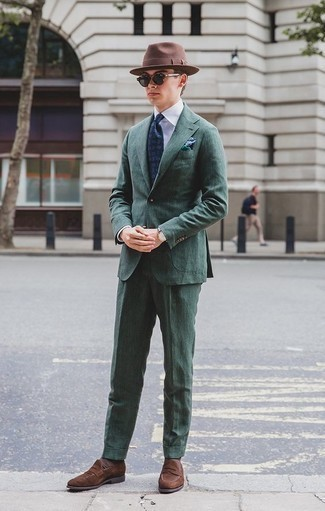 How to Wear Brown Socks For Men: If you're searching for a casual and at the same time seriously stylish look, wear a dark green suit and brown socks. A pair of brown suede loafers immediately polishes off the outfit.