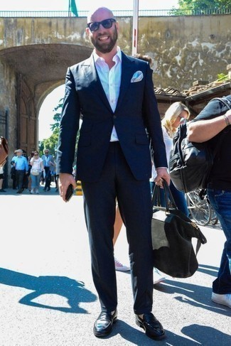 How to Wear a White Dress Shirt For Men: We're loving the way this pairing of a white dress shirt and a navy suit immediately makes any man look classy and smart. Here's how to dial it down: black leather loafers.
