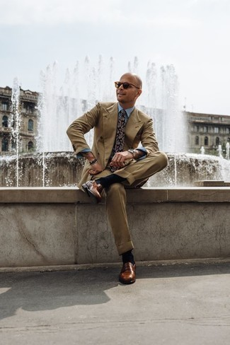 How to Wear a Black Beaded Bracelet For Men: A tan suit and a black beaded bracelet worn together are the perfect ensemble for men who appreciate casual and cool getups. Complete your ensemble with brown leather loafers to completely spice up the outfit.