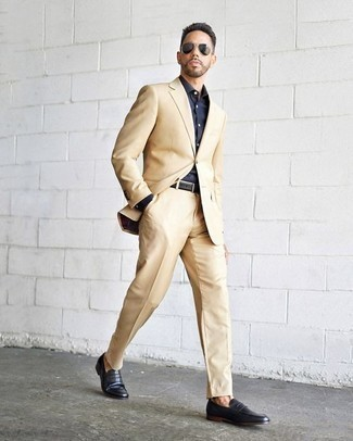How to Wear Dress Shoes For Men: This elegant pairing of a beige suit and a navy dress shirt will allow you to parade your styling prowess. Dress shoes make this ensemble complete.