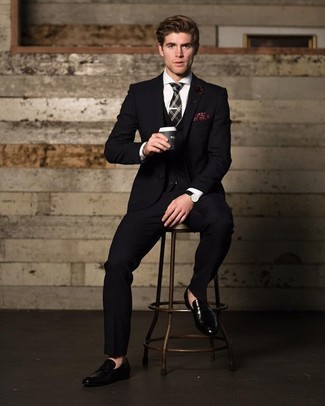 How to wear: black plaid tie, black leather loafers, white dress shirt, black three piece suit