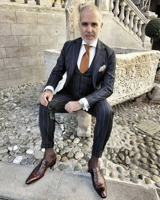 How to wear: brown tie, dark brown leather loafers, white dress shirt, black vertical striped three piece suit