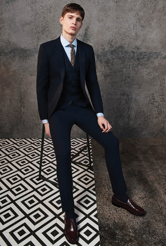 How to Wear a Black Three Piece Suit: No doubt, you'll look smooth and dapper in a black three piece suit and a light blue dress shirt. Put a fresh spin on an otherwise traditional look by wearing a pair of dark brown leather loafers.