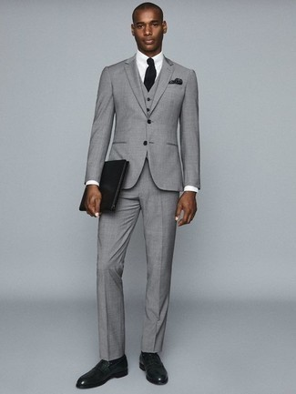 How to Wear a Grey Three Piece Suit: For an outfit that's nothing less than wow-worthy, reach for a grey three piece suit and a white dress shirt. Send an otherwise sober look a more relaxed path with a pair of dark green leather loafers.