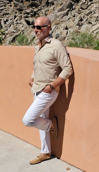 Men's Looks & Outfits: What To Wear In 2020: A beige gingham long sleeve shirt and white jeans are essential in any man's versatile casual sartorial arsenal. Rounding off with tan suede loafers is an easy way to breathe a hint of class into this getup.