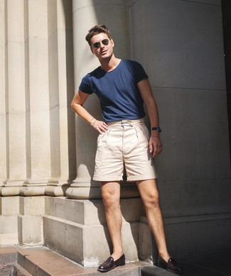 How to wear: olive sunglasses, burgundy leather loafers, beige shorts, navy crew-neck t-shirt