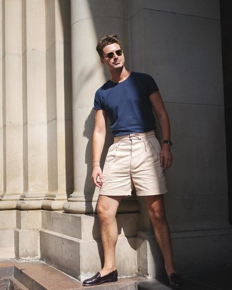 How to wear: olive sunglasses, dark brown leather loafers, beige shorts, navy crew-neck t-shirt