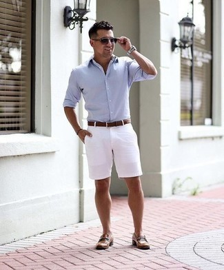 How to Wear Violet Sunglasses For Men: We all want comfort when it comes to styling, and this casual combination of a light blue long sleeve shirt and violet sunglasses is a perfect example of that. Complete this look with brown leather loafers to effortlessly rev up the classy factor of any outfit.