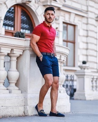 Men's Looks & Outfits: What To Wear In 2020: A red polo and navy shorts are great menswear essentials that will integrate really well within your off-duty fashion mix. Show off your elegant side by rounding off with a pair of navy canvas loafers.