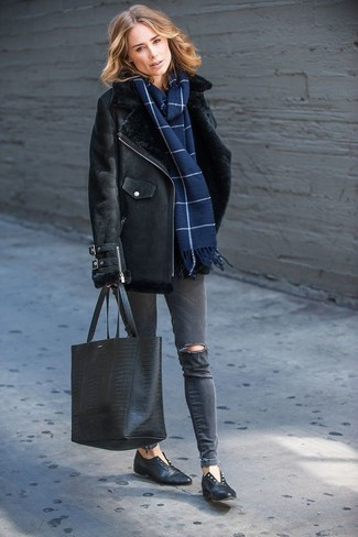 How to wear: black snake leather tote bag, black leather loafers, charcoal ripped skinny jeans, black shearling jacket