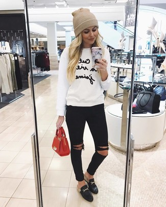 How to wear: red leather satchel bag, black leather loafers, black ripped skinny jeans, white and black print sweatshirt