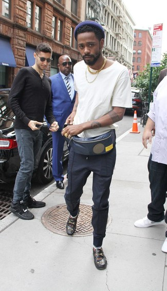 How to wear: navy fanny pack, black embroidered leather loafers, navy sweatpants, white crew-neck t-shirt