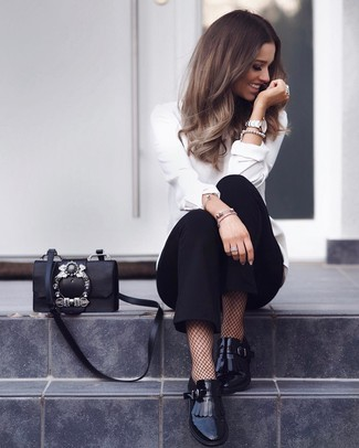 How to wear: black embellished leather crossbody bag, black fringe leather loafers, black tapered pants, white long sleeve blouse
