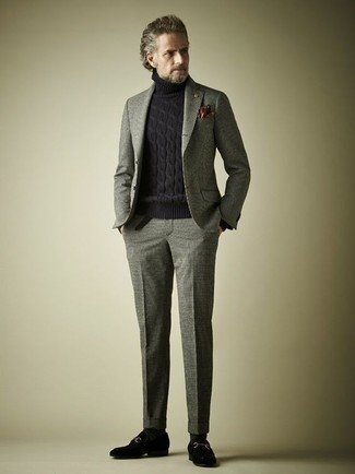 How to Wear a Grey Wool Suit: We love how this combo of a grey wool suit and a black knit wool turtleneck instantly makes any gentleman look smart and sophisticated. To bring out a classy side of you, complete your outfit with black suede loafers.