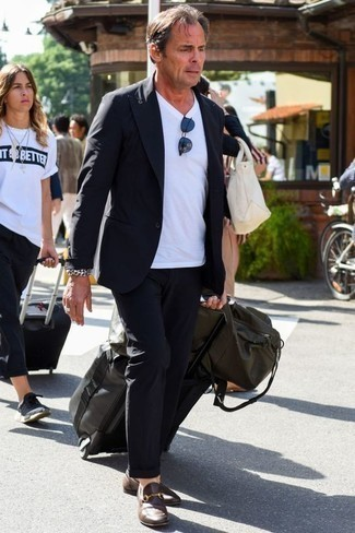 How to Wear Brown Leather Loafers After 40 For Men: Bump up your fashion game in this combo of a navy suit and a white v-neck t-shirt. You can take a classic approach with footwear and introduce brown leather loafers to your look.