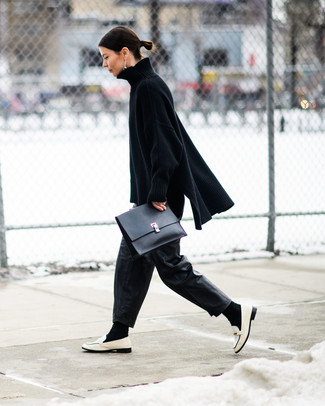 How to Wear Black Leather Wide Leg Pants: A black knit oversized sweater and black leather wide leg pants are a cool getup to have in your current lineup. Why not take a classic approach with shoes and add white leather loafers to the equation?