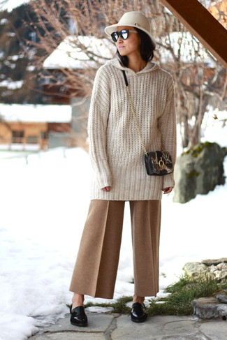 How to wear: black snake leather crossbody bag, black leather loafers, tan wide leg pants, beige knit oversized sweater