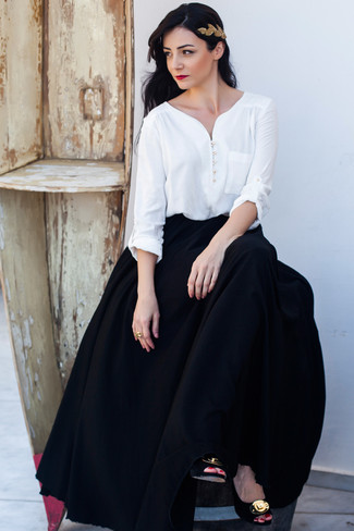 A white long sleeve blouse and a black pleated maxi skirt is a good pairing to impress your crush on a date night. A pair of black and gold embellished suede pumps will add some real flair to this getup. This combo is super functional and will help you out in unpredictable spring weather.