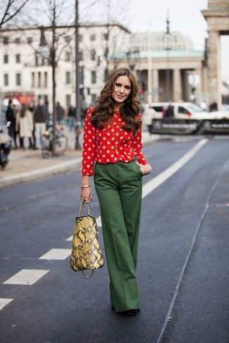 This combination of a red polka dot long sleeve blouse and hunter green wide leg pants is perfect for a night out or smart-casual occasions. Consider black suede pumps as the glue that will bring your outfit together. Keep the autumn blues at bay in a chic outfit like this one.