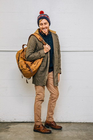 How to Wear a Navy Fair Isle Beanie For Men: A big thumbs up to this urban pairing of an olive parka and a navy fair isle beanie! Rev up the cool of your look by slipping into brown leather casual boots.