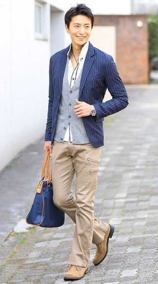 How to Wear a Navy Canvas Tote Bag For Men: Go for a pared down but casual and cool option putting together a navy vertical striped blazer and a navy canvas tote bag. Introduce tan suede desert boots to this look to make the outfit a bit more refined.
