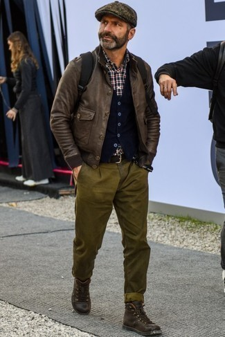 How to Wear a Dark Brown Flat Cap For Men: Try teaming a dark brown leather bomber jacket with a dark brown flat cap if you wish to look laid-back and cool without spending too much time. Add a little kick to the outfit with dark brown leather casual boots.