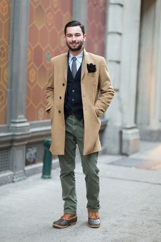 How to wear: olive chinos, light blue long sleeve shirt, navy cardigan, camel overcoat