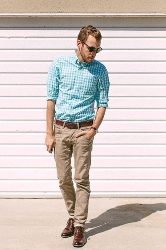 How to wear: aquamarine gingham long sleeve shirt, khaki chinos, dark brown leather derby shoes, brown leather belt